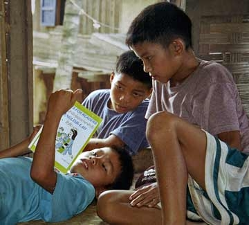 boys     reading at   the library in Nong Khiaw